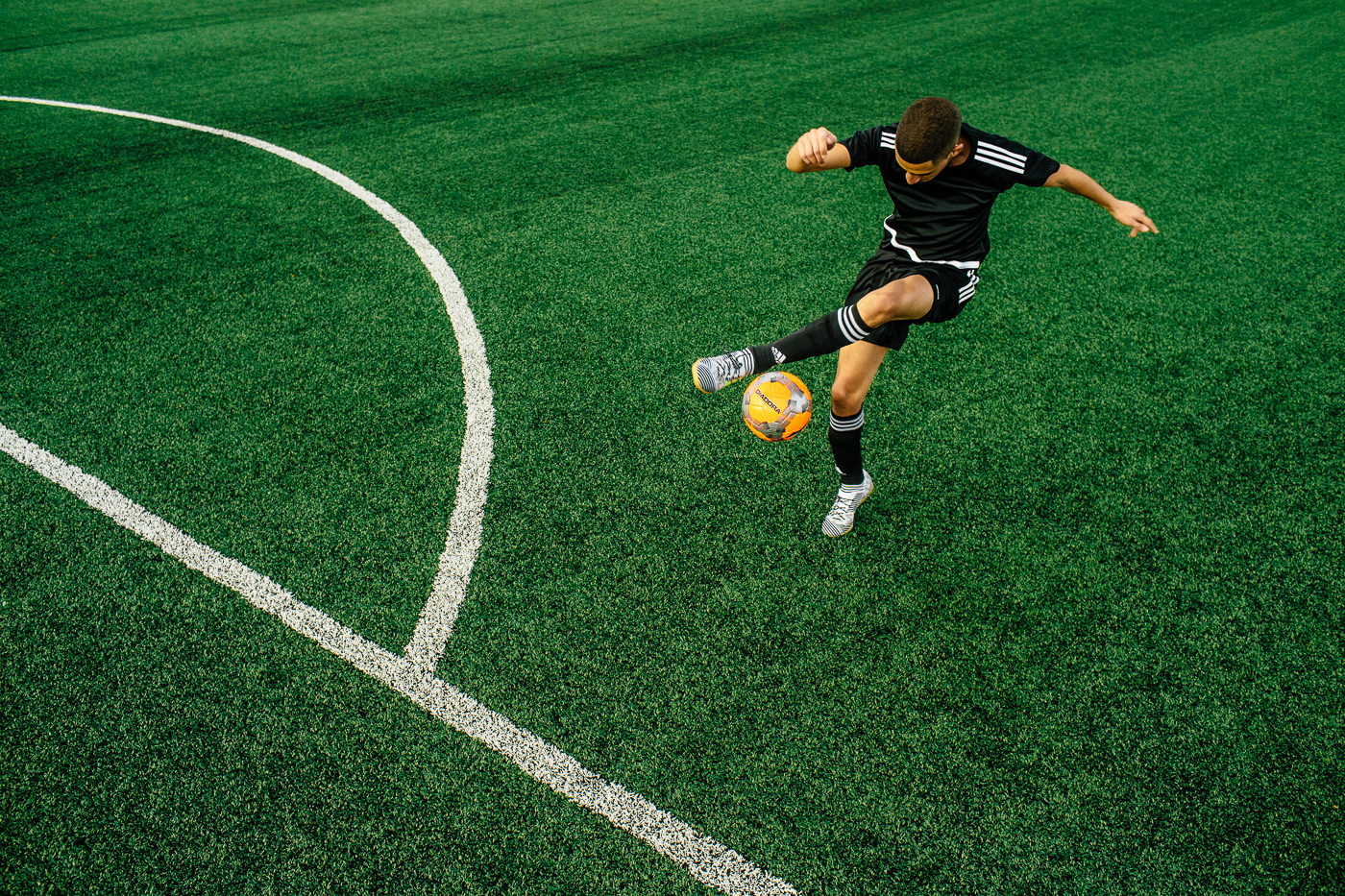 photo commerciale campagne soccer sports experts terrain de football